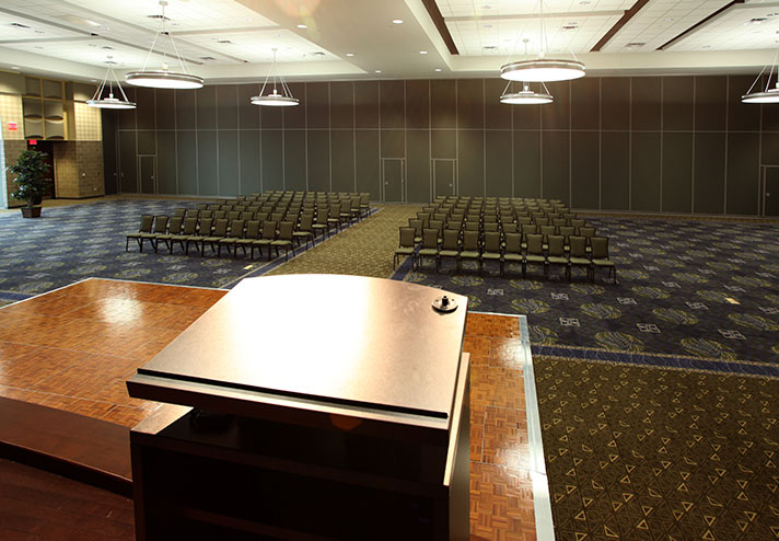 Image of podium point of view in convention center room