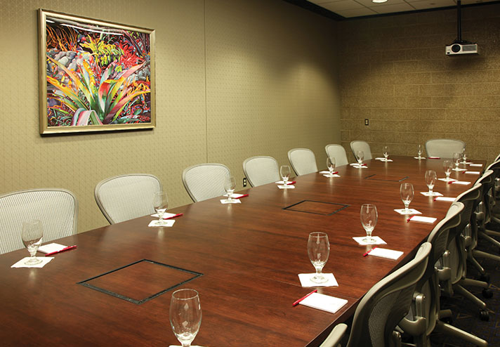View of meeting room set up with small conference table