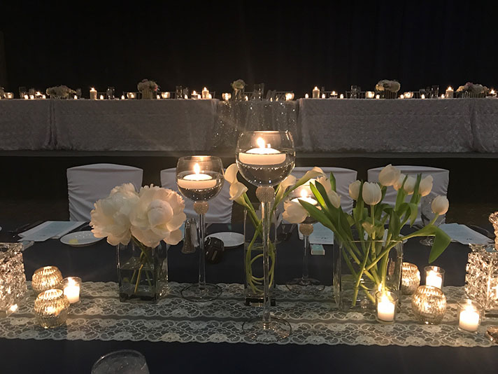 View of wedding gallery - Candles on a table with flowers