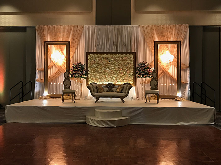 View of wedding gallery -  Conference center stage decorated with couch