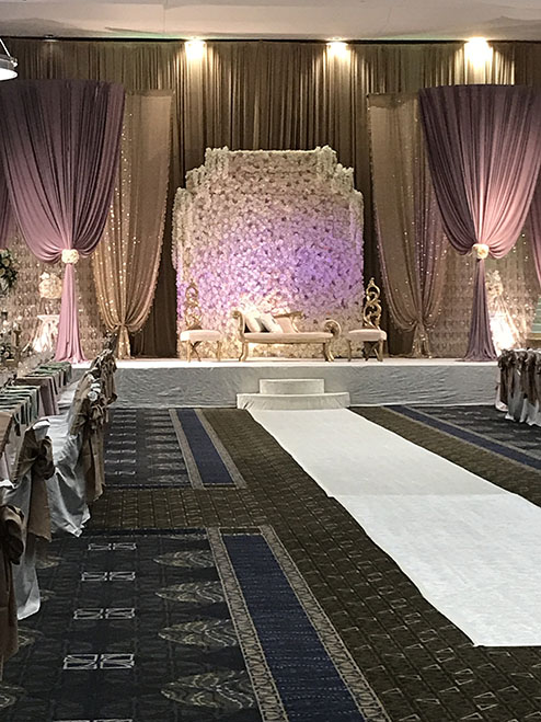 View of wedding gallery - stage decorated with purple lighting