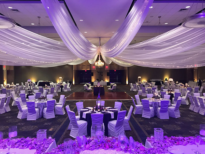 View of wedding gallery -  Conference center decorated in white with purple lighting