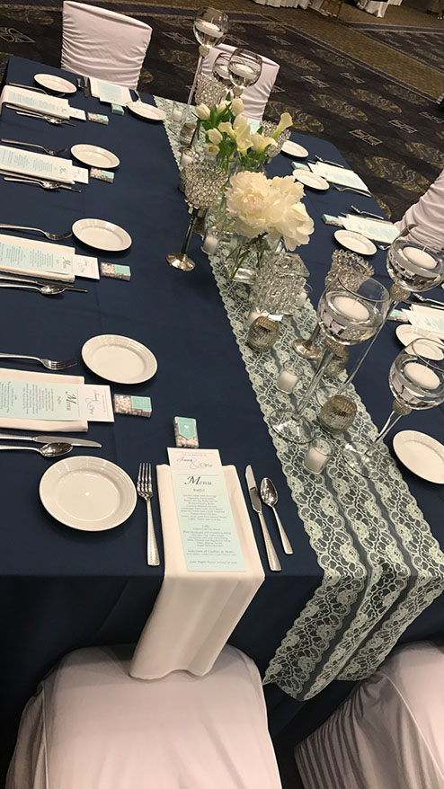 View of wedding gallery - overhead shot of table with blue cloth and formal plate settings