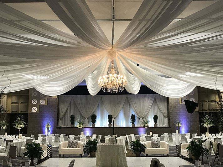 View of wedding gallery - dance floor with stage and couches beyond the dance floor