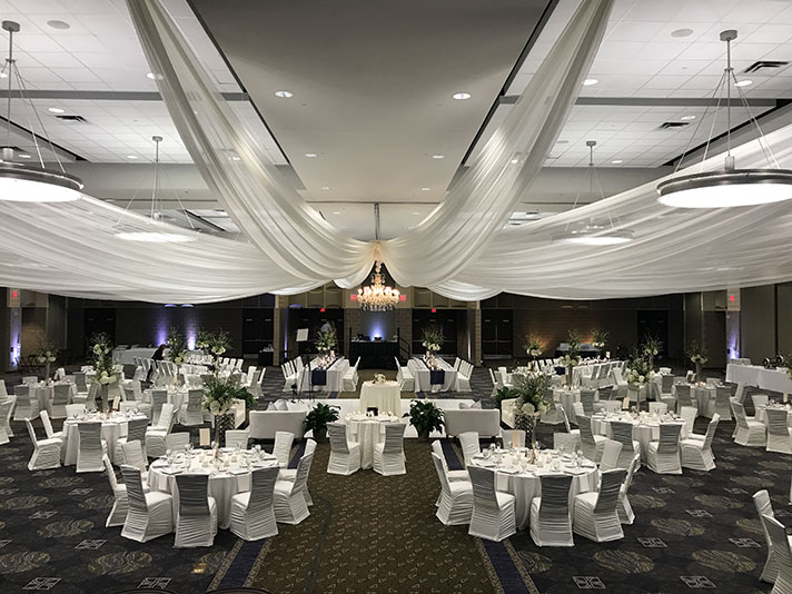 View of wedding gallery -  Conference center decorated in white - draped ceiling of fabric above